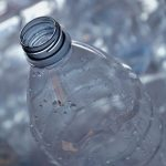 This is the reason why PET bottles are separated by removing the cap and label!